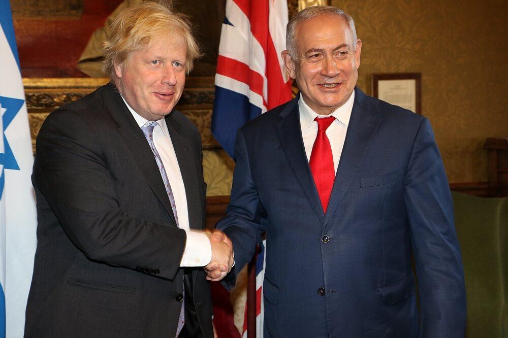 """""""מחויבות בלתי מעורערת לביטחונה וליציבותה של ישראל"""". נתניהו וג'ונסון. צילום: משרד החוץ הבריטי"""